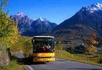 A postal bus in a mountain region.