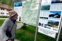 How can you inform visitors to a protected area and raise their awareness?